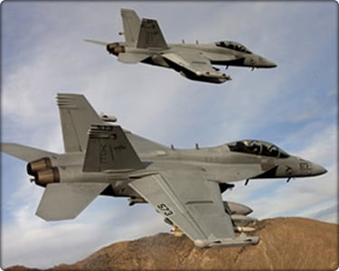 "A pair of Boeing EA-18G Growlers, XE 573 166857 and XE 571 166855 of the VX-9 ""Vampires"" bank over the desert"