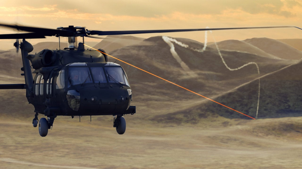Rendering of an ATIRCM system shining laser light to defeat infrared missile threats
