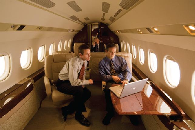 Passengers on laptop using in-flight internet