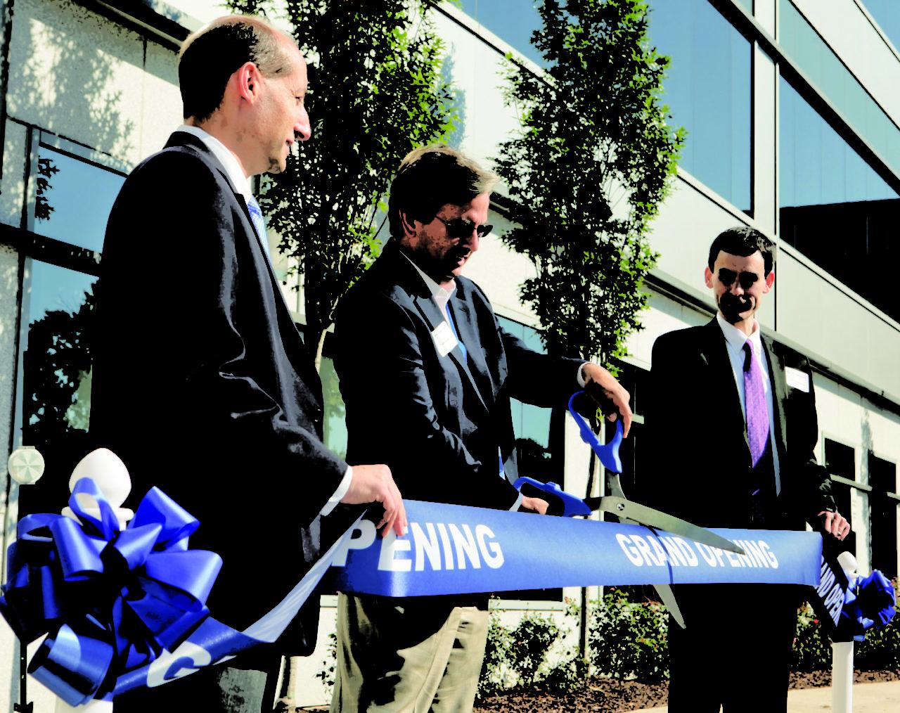 UTC Aerospace executives inaugurate the new facility with a ribbon-cutting ceremony