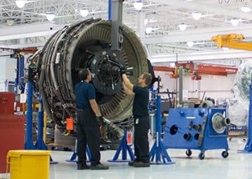 Workers at a Lockheed Martin Commercial Engine Solutions facility
