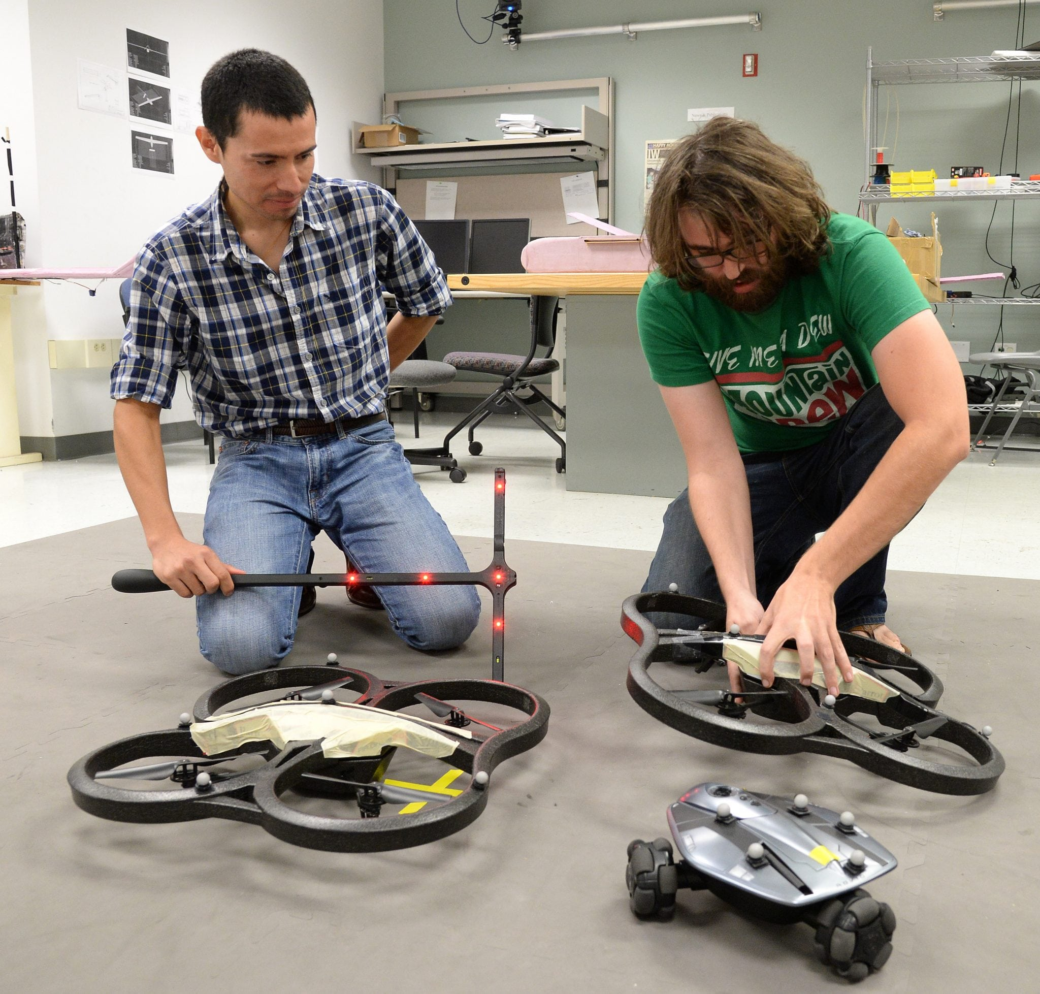 Luis Garcia Carrillo works with a student to test unmanned aerial vehicles capable of vertical flight