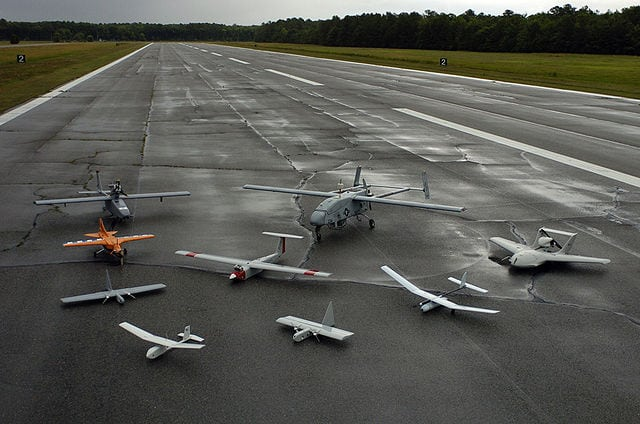 A group photo of aerial demonstrators at the United States Naval unmanned aerial vehicle air demonstration (2005)