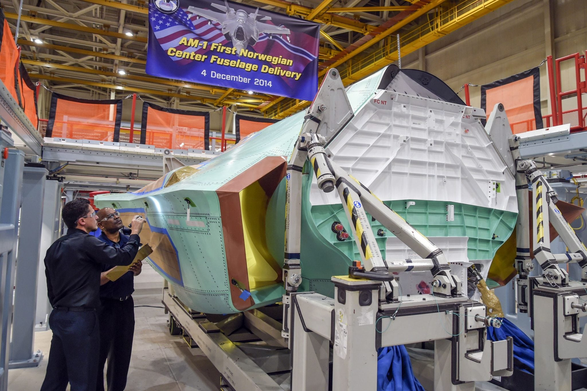 Technicians at Northrop Grumman's Palmdale (Calif.) Aircraft Integration Center of Excellence conduct final quality inspections on the center fuselage for AM-1
