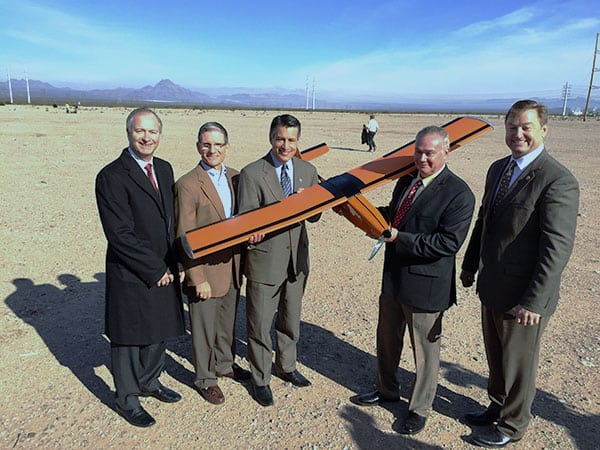 Pictured in the photo from left to right: Steve Hill, Nevada Governor's Office of Economic Development (GOED), Representative Joe Heck , Governor of Nevada, Brian Sandoval, Sensurion Aerospace CEO, Captain Joe Burns, Senator Dean Heller hold Magpie MP-1 UAS