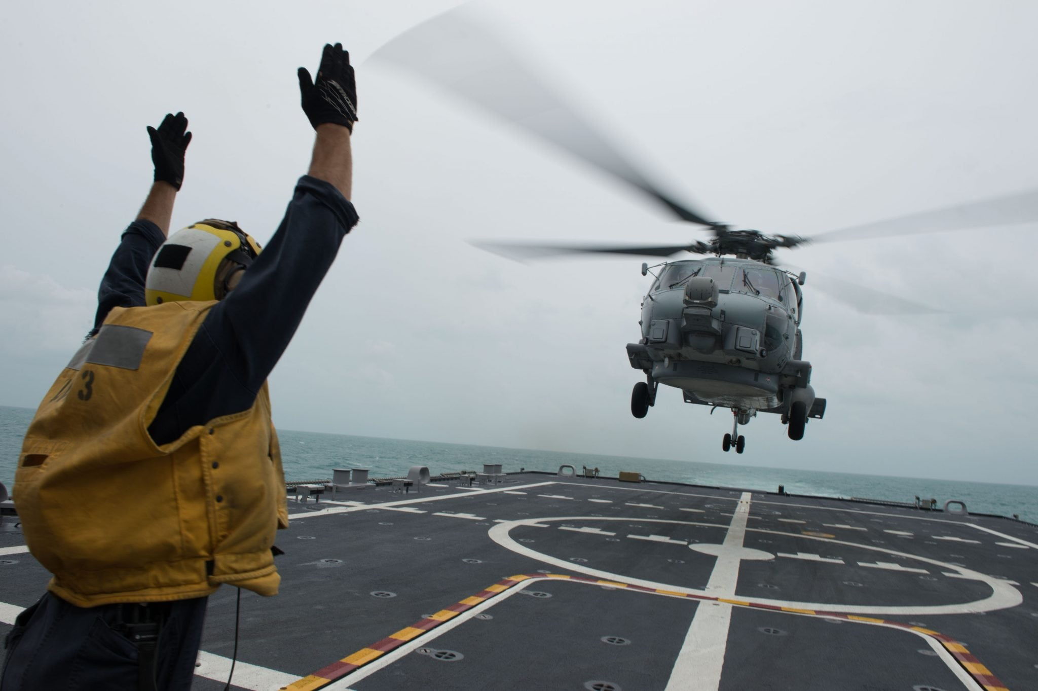 MH-60R Sea Hawk helicopter onducting helicopter search and recovery operations as part of the Indonesian-led efforts to locate missing AirAsia Flight QZ8501
