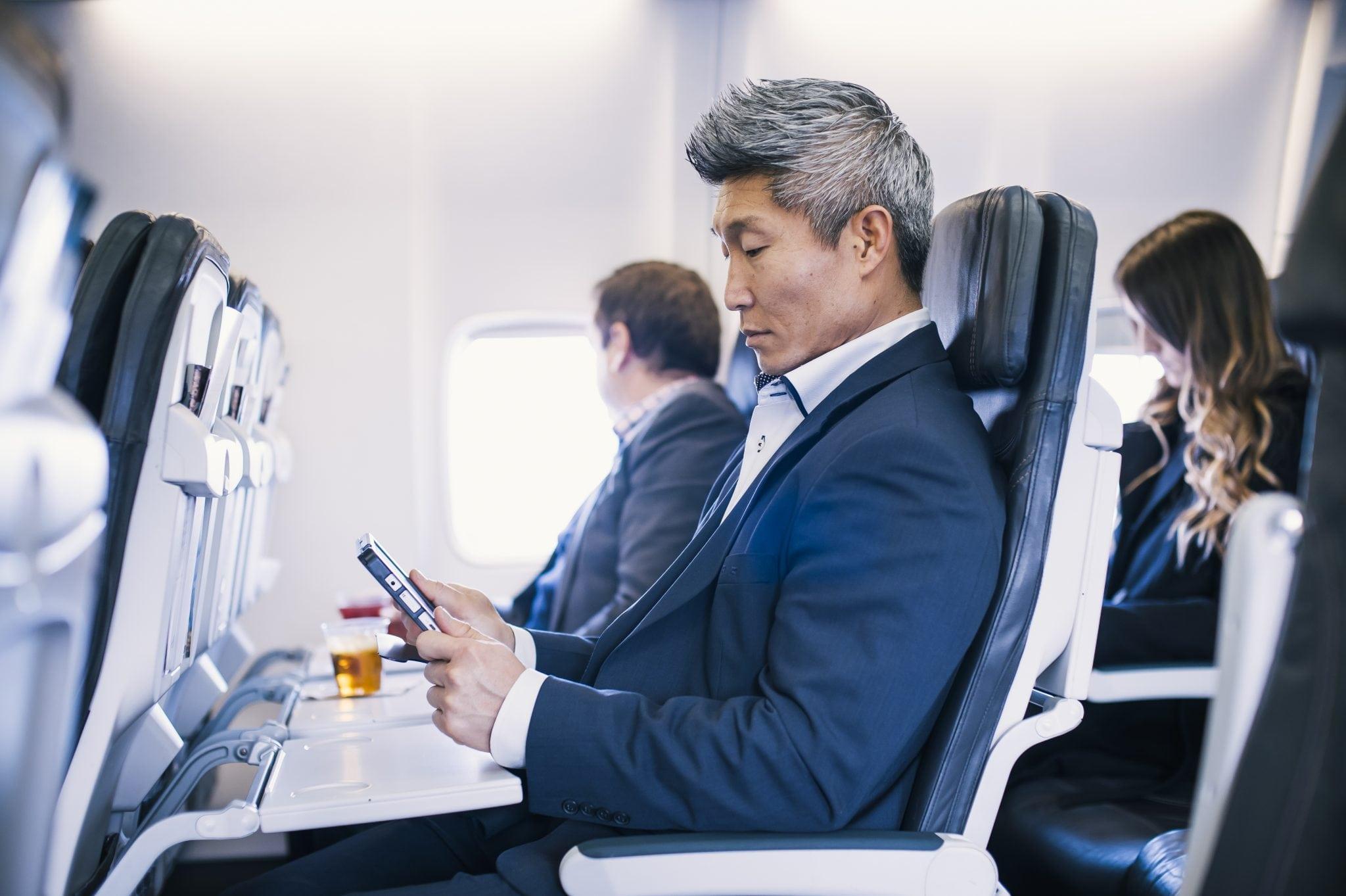 Alaska Air passenger accessing IFE via their personal tablet