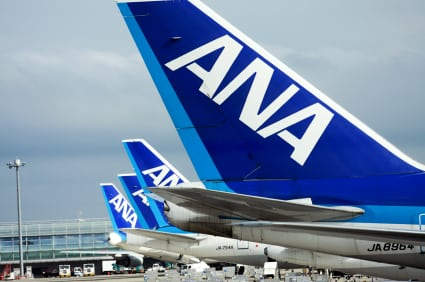 A row of aircraft with ANA livery