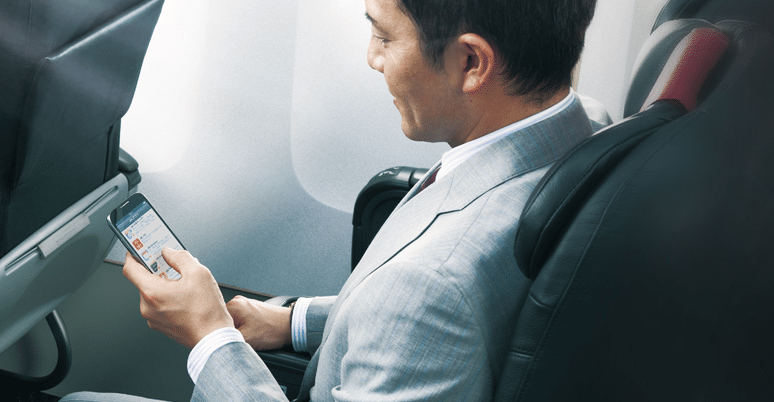 JAL passenger using Wi-Fi in flight on a smartphone