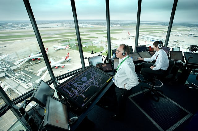 ATCs overlook operations from inside the Heathrow tower