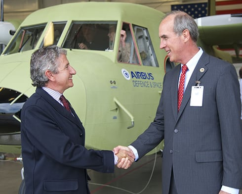 Juan Uriarte, head of Airbus Defense and Space U.S. military aircraft services greets Mobile Mayor Sandy Stimpson at the first U.S. C212 aircraft operators conference last year in Mobile, Ala. Photo: Airbus Group
