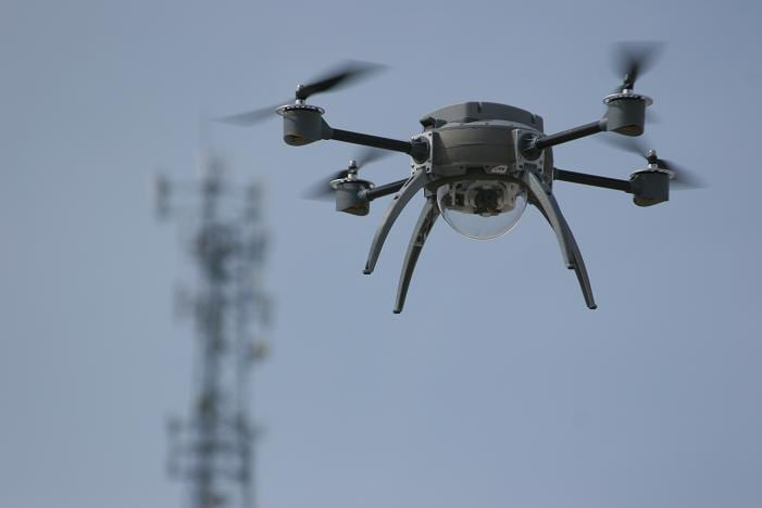 An unmanned aerial system capable of taking aerial photos