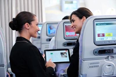 Flight attendant using tablet