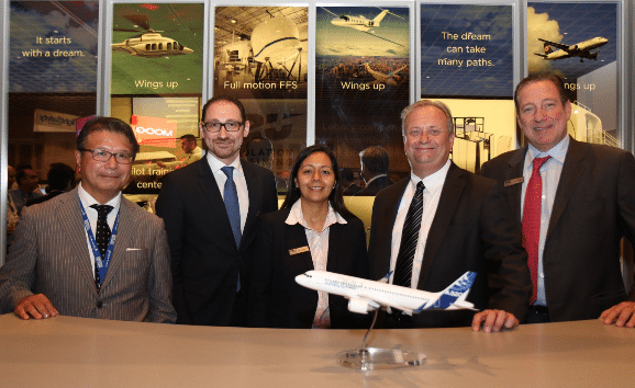 Company executives finalize agreement during 2015 World Aviation Training Symposium in Orlando