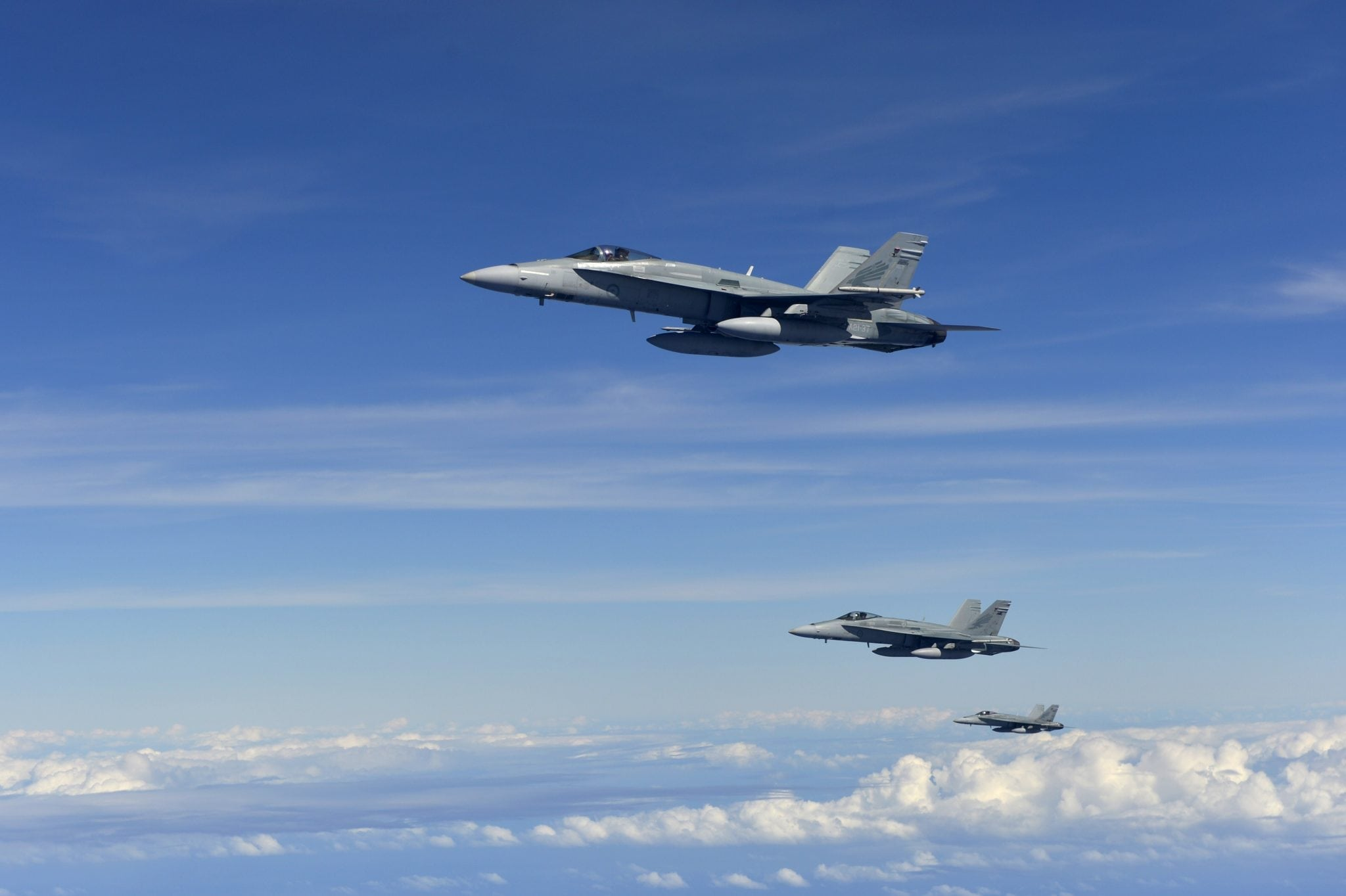 Three RAAF FA-18 Hornets in formation after refueling U.S. Air Force photo by Senior Airman Matthew Bruch