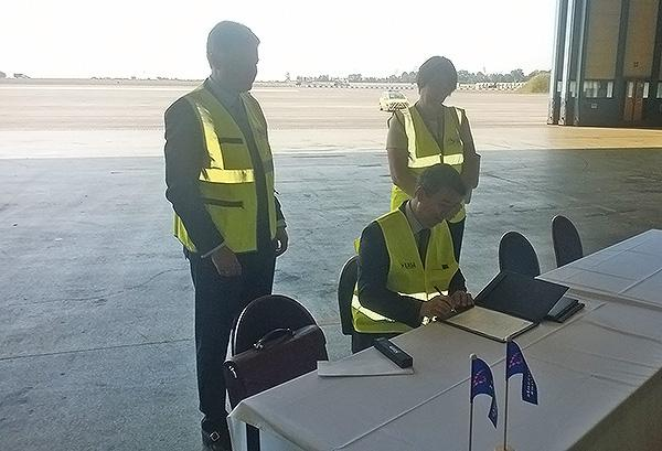 EASA's Executive Director Patrick Ky signs the 22 authorizations during a ceremony held at Brussels airport, in the presence of Commissioner Violeta Bulc