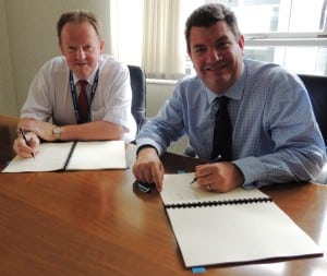 Martin Rolfe, NATS Chief Executive Officer and Graham Keddie, Managing Director, Belfast International Airport Sign agreement to extend service