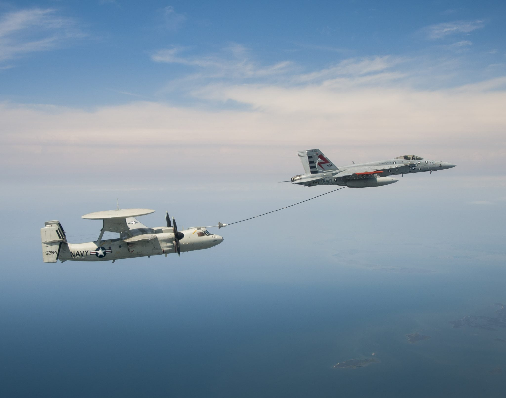 An E-2C test aircraft assigned to Air Test and Evaluation Squadron (VX) 20 conducts an aerial refueling dry-plug engagement with an F/A-18