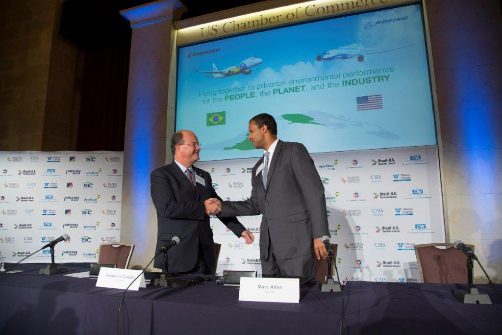 Embraer and Boeing officials sign agreement to collaborate on ecoDemonstrator.