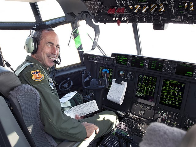 Gen. Raymond Johns, commander of the U.S. Air Force's Air Mobility Command, in cockpit of C-130J