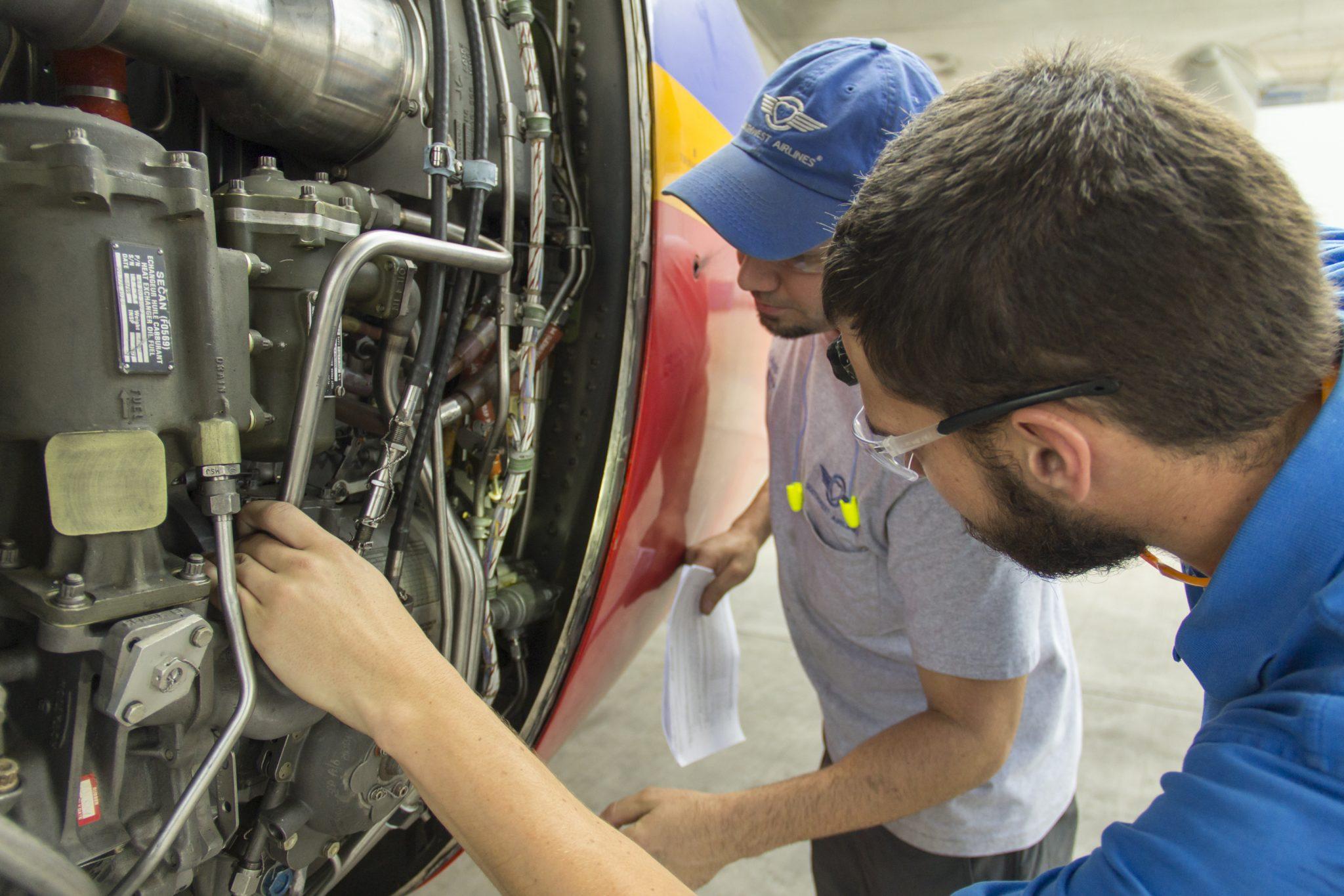 Maintenance technicians working on an aircraft