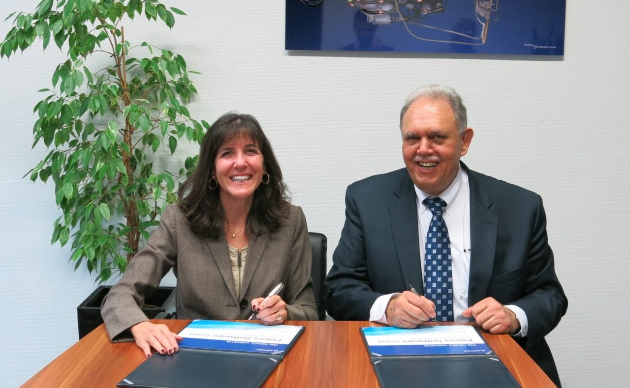 Boeing Flight Services Vice President Sherry Carbary and Wilfried Peters, the director of Ab-Initio Training Programs at the Boeing Flight Services Signing