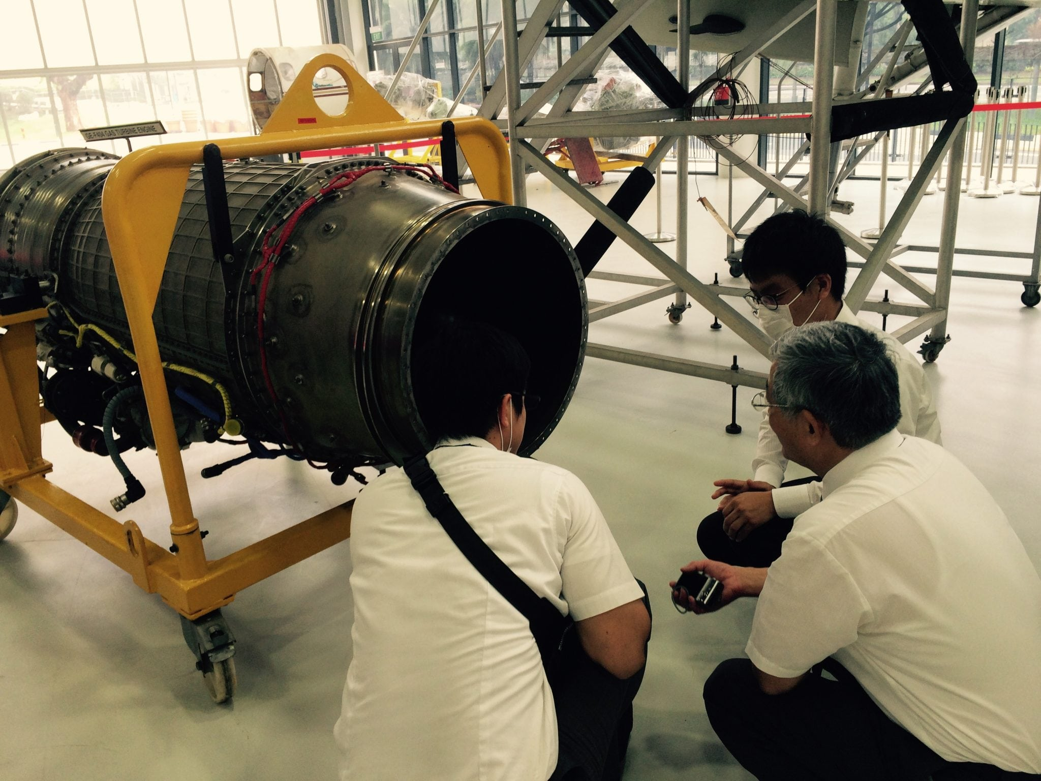 Students studying an aircraft part at the Singapore Polytechnic AeroHub