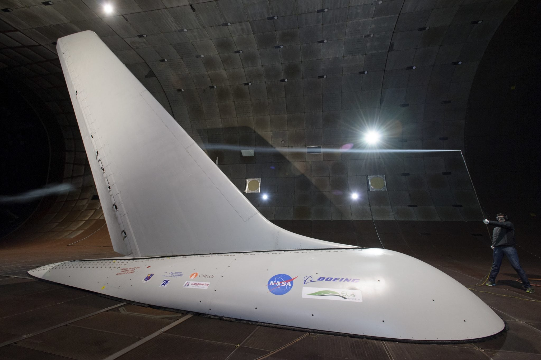 Researchers with NASA's Environmentally Responsible Aviation project coordinated wind-tunnel tests of an Active Flow Control system — tiny jets installed on a full-size aircraft vertical tail that blow air — to prove they would provide enough side force and stability that it might someday be possible to design smaller vertical tails that would reduce drag and save fuel