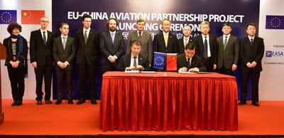 Representatives from each country sign the EU and China Aviation Partnership Project