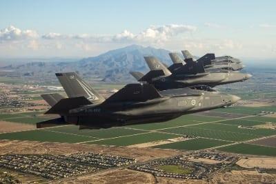 Four F-35 Lighting II aircraft fly over Luke Air Force Base, Arizona