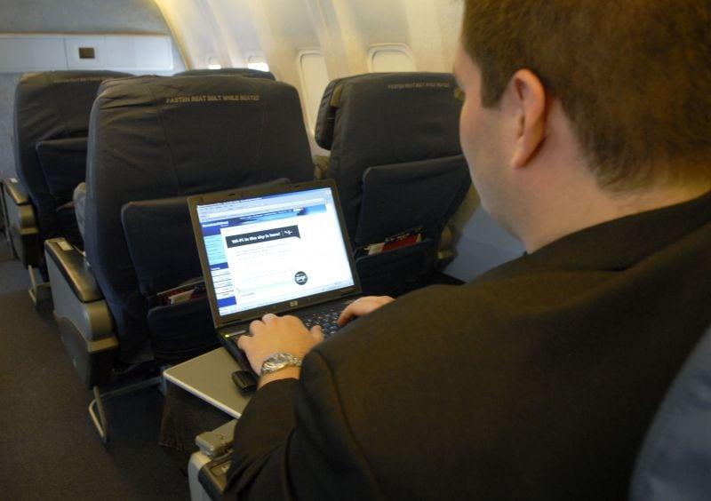 Airline passenger using Gogo