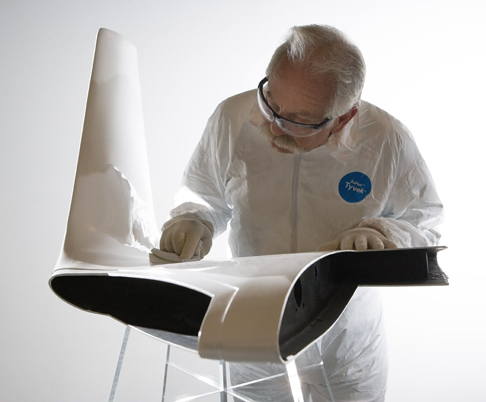 Employee working on aircraft wing tip