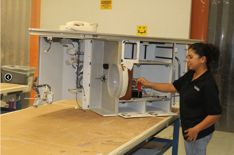 InTech employee working on an aircraft system