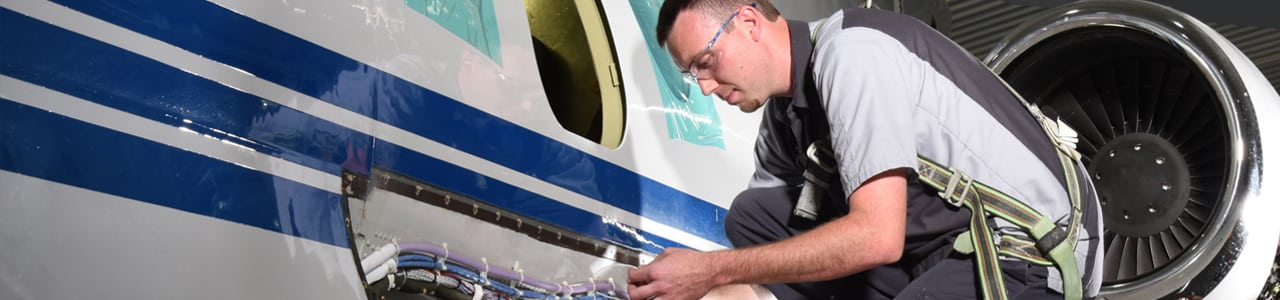 Technician working on aircraft