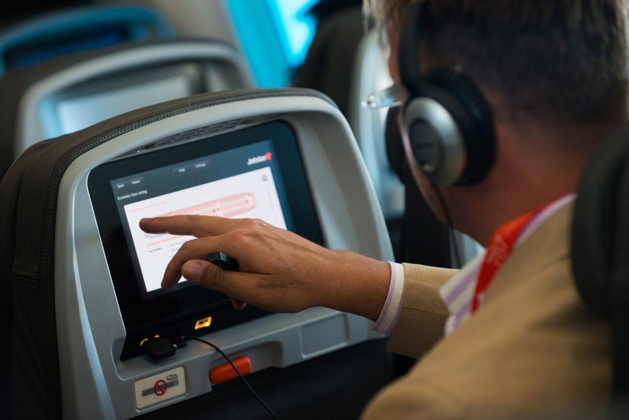 Passenger using IFE system