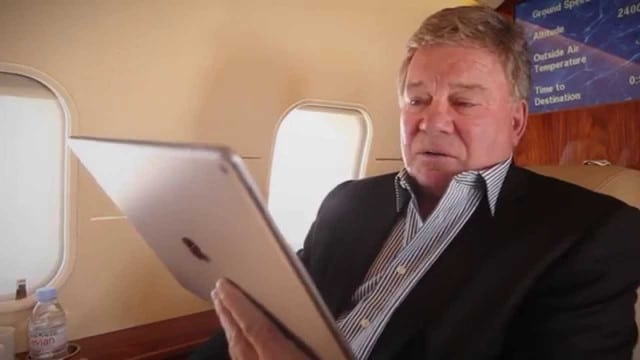 Actor William Shatner using Bombardier's WAVE IFC solution in flight