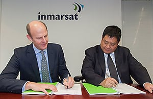Inmarsat CEO, Rupert Pearce, and MCN Vice President of Sales & Marketing, Mr. Song Zhen, signing an agreement for MCN to become a Global Xpress Value Added Reseller (GX VAR) in China in April 2015