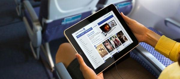 Passenger using an iPad in flight