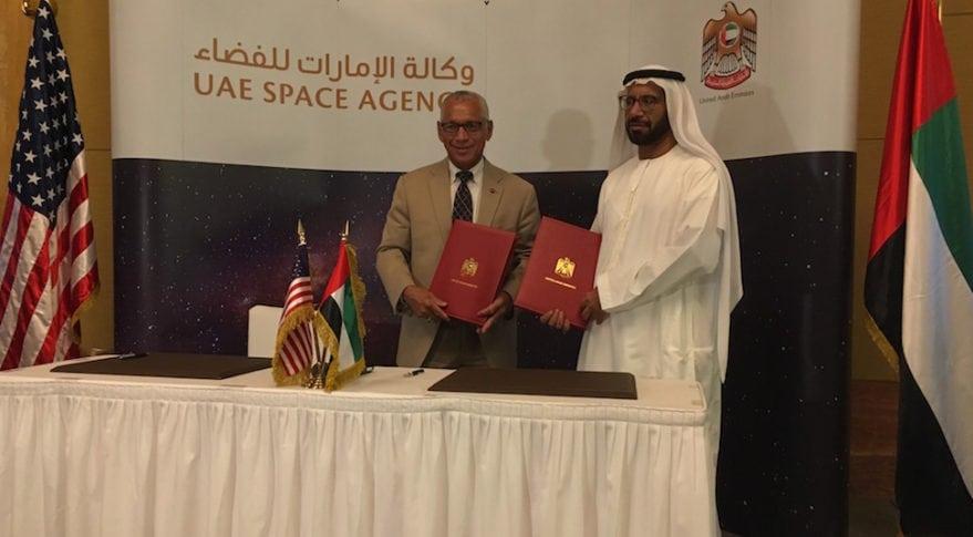 UAE Space Agency Chairman Khalifa Al Romaithi and NASA Administrator Charles Bolden pose with collaborative agreement for aeronautics, space exploration
