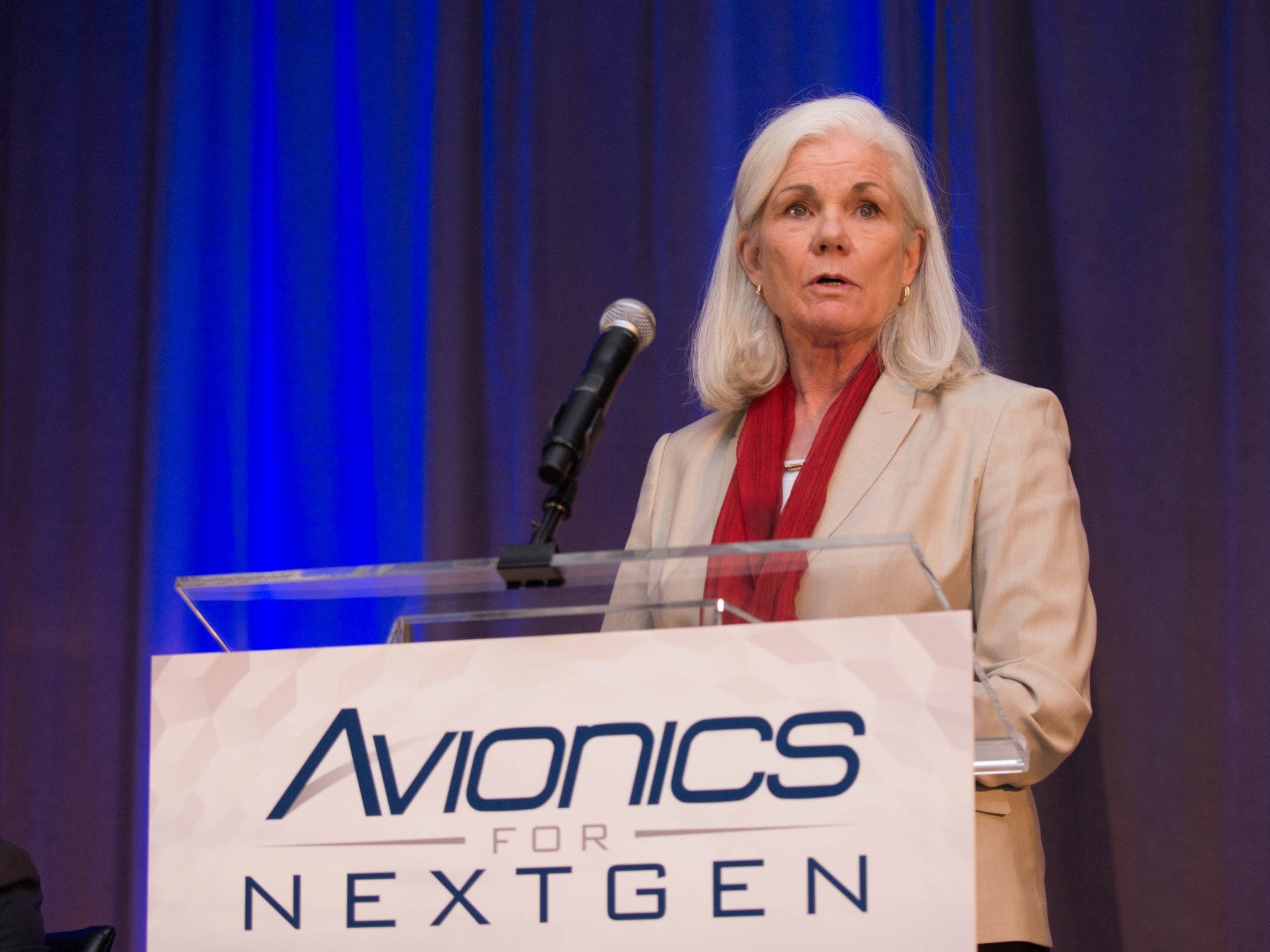 Caption: Mary McMillan, Vice President Aviation Safety and Operational Services, Inmarsat, speaks to upcoming flight tracking requirements during the Avionics for NextGen conference on Sept. 28.