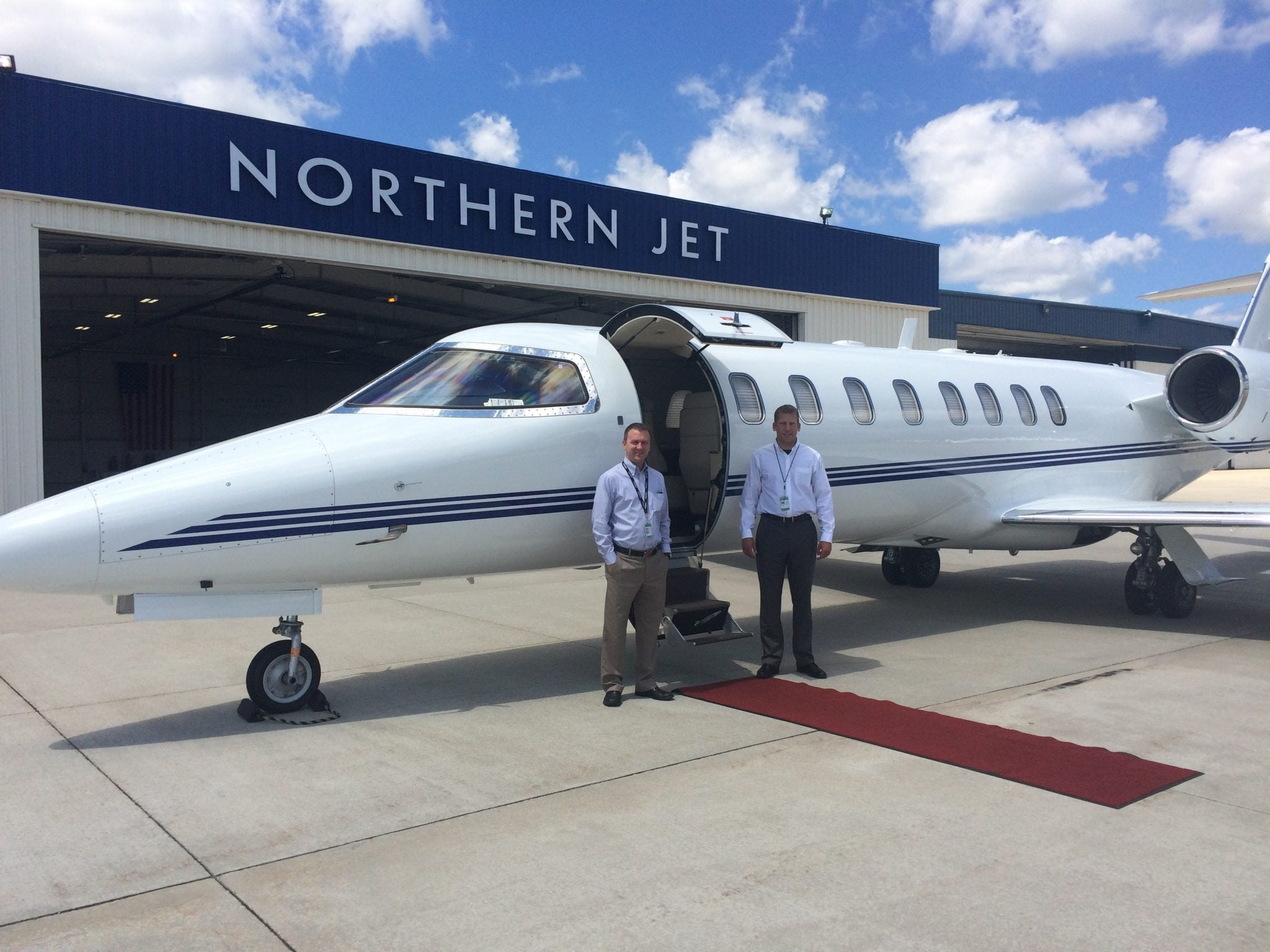 Pilots Steve Edmondson, left, and Andy Heemstra pose in front of the Bombardier Learjet 45XR they flew to establish the world record for a flight between Grand Rapids and Naples, Florida.
