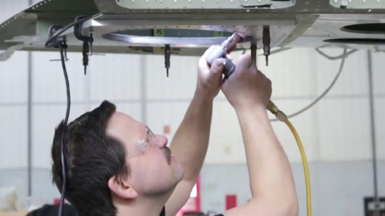 Constant Aviation maintenance technician working on an aircraft