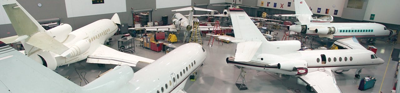 Falcon business jets in Duncan Aviation hangar