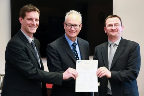 EASA And CFM officials hold certificate certifying the LEAP 1C engine. Photo: EASA