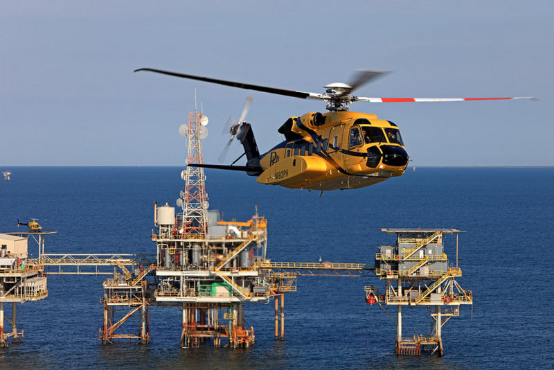 A PHI Sikorsky S-92A cruises past an oil rig in the Gulf of Mexico. Photo: Lockheed Martin.