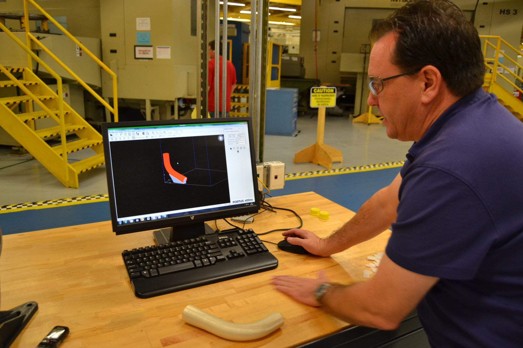170202-N-LQ867-001 JACKSONVILLE, Fla. (Feb. 2, 2017) Randy Meeker, an Fleet Readiness Center Southeast tooling designer, shows how a piece of environmental duct for a T-44 Pegasus was designed and created with a 3D printer in the facility's manufacturing department. (U.S. Navy photo by Clifford Davis/Released)