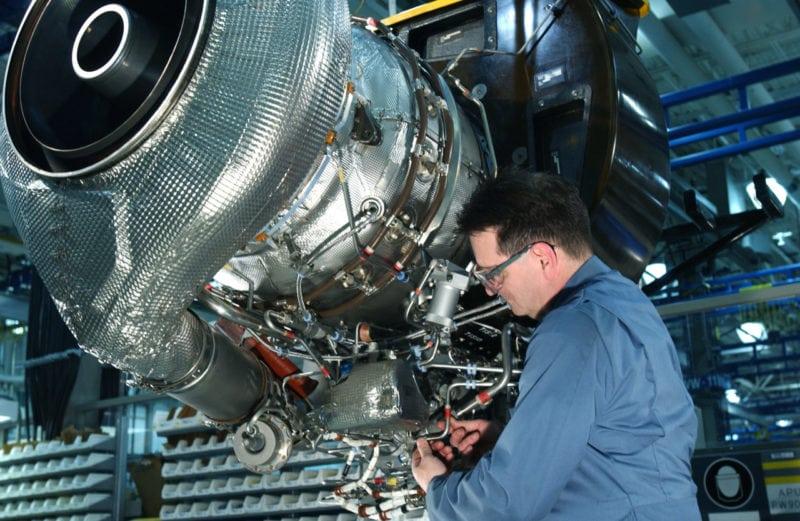 A technician works on a PW901 engine. Photo: Pratt & Whitney Canada.