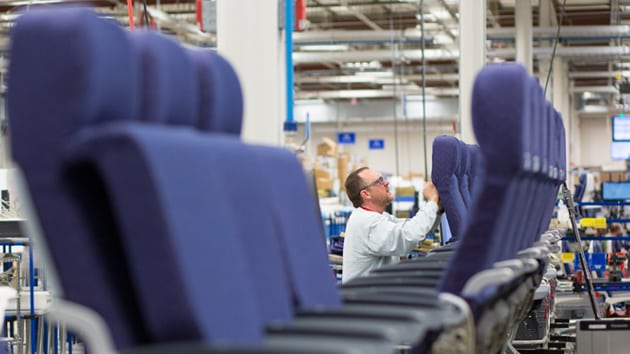 An employee from Rockwell Collins' new Interior Systems business building airline cabin seats at its Winston-Salem, North Carolina-based facility. Photo courtesy of Rockwell Collins