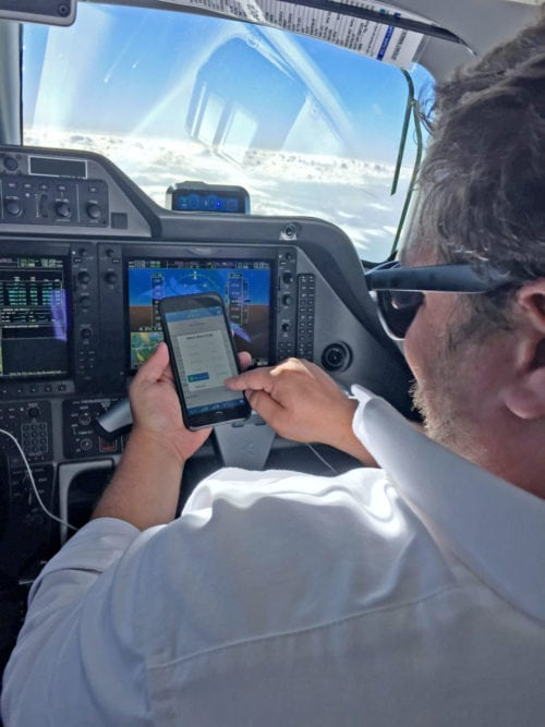 Crewmember using Blue Sky Network in cockpit. Photo: Blue Sky Network.
