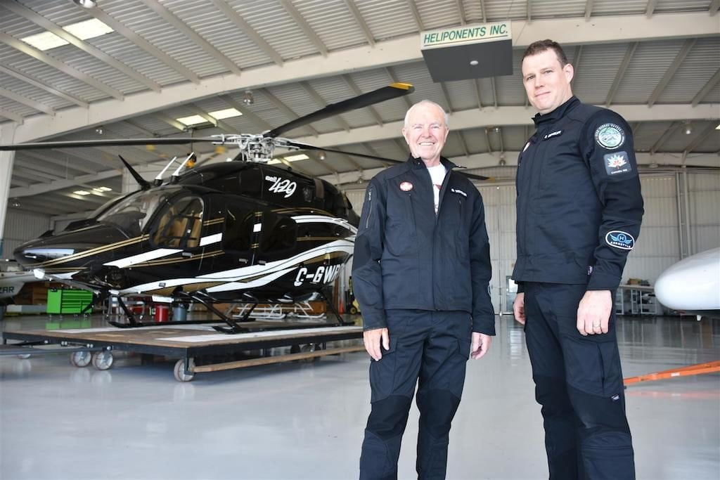 Father and son duo Bob and Steven Dengler in front of the Bell 429 helicopter they'll be piloting during their journey as the world's first Canadian helicopter flight around the world.